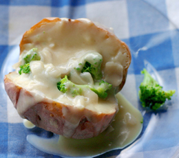 broccoli and cheddar sauce on a baked potato